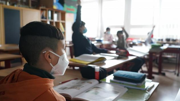 Moderna is testing its COVID-19 vaccine in young children; its vaccine is currently authorized for people ages 18 and up. Here, third-grade children attend school this month in Berlin, as classes were allowed to meet in person at 50% capacity.