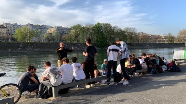 Young people gathered Wednesday by the Seine River in Paris, largely without masks and without social distancing. French President Emmanuel Macron has ordered the country into a third lockdown because of the continued spread of COVID-19.