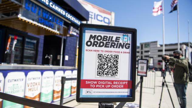 A mobile ordering sign is seen on March 30 at a vending station in Nationals Park, home of the Washington Nationals. The Nats, along with many other teams in baseball, are implementing new safety protocols, including for ordering food, as a new season ki