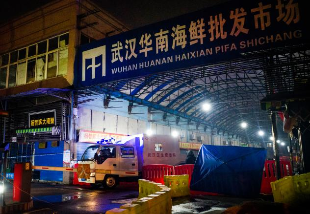 When COVID-19 first broke out in Wuhan, scientists tracked a large number of the cases to the Huanan Seafood Market in Wuhan. Above: The Wuhan Hygiene Emergency Response Team departs the market on Jan. 11, 2020, after it had been shut down to prevent the
