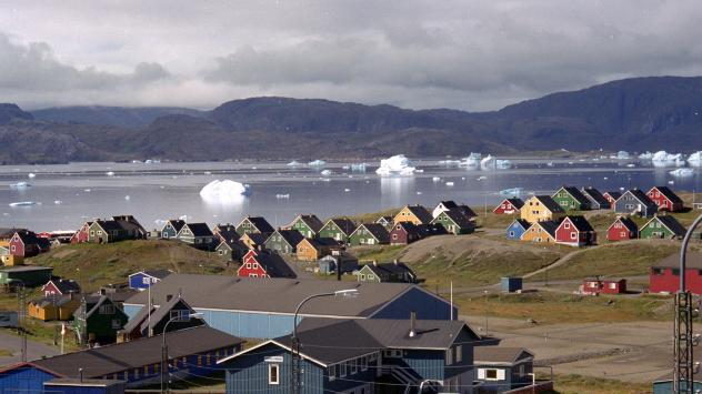 Giant icebergs float in the fjord in the southern Greenland town of Narsaq, the site of a controversial Australian-led uranium and rare-earth mining project. The open-pit mine has divided opinion on the island, which goes to the polls on Tuesday.