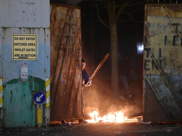 """Skirmishes erupt at the """"peace wall"""" dividing Protestant and Catholic neighborhoods in Belfast, Northern Ireland, on Wednesday night."""