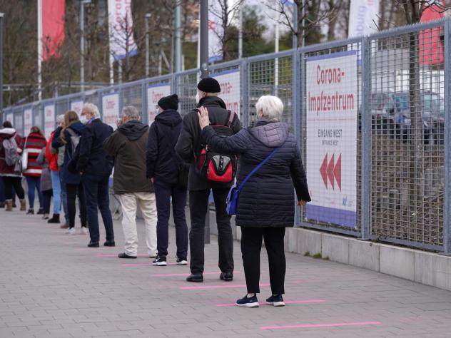 Lines form in front of a vaccination center Monday in Hamburg, Germany.