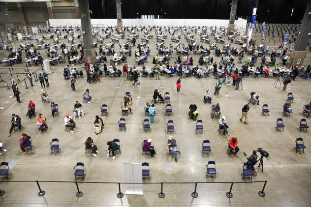 """A mass vaccination site at the Lumen Field Event Center in Seattle had plenty of takers for the COVID-19 vaccine when it opened in mid-March. Though some relatively rare cases of coronavirus infection have been documented despite vaccination, """"I don't se"""
