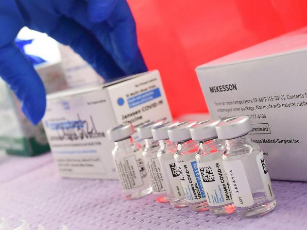 Bottles of the single-dose Johnson & Johnson Janssen COVID-19 vaccine await transfer into syringes for administering in March in Los Angeles. The CDC had called on Tuesday for a pause in administering the vaccine.