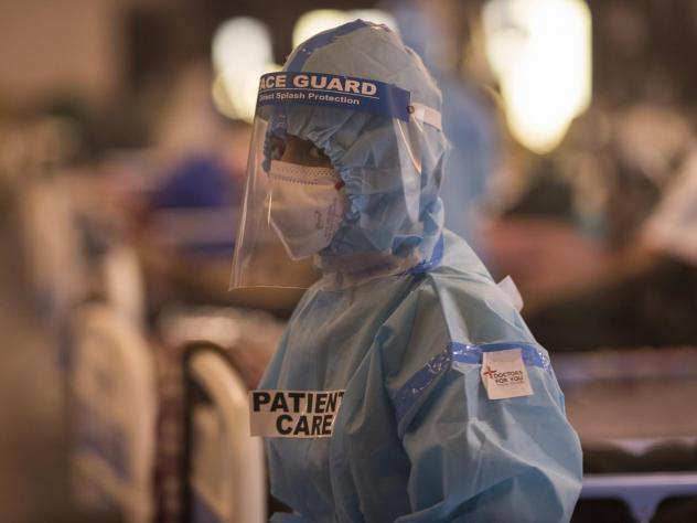 A medical worker is seen at a quarantine center for Covid-19 coronavirus infected patients at a banquet hall, which was converted into an isolation center to handle the rising cases of infection in New Delhi, India.