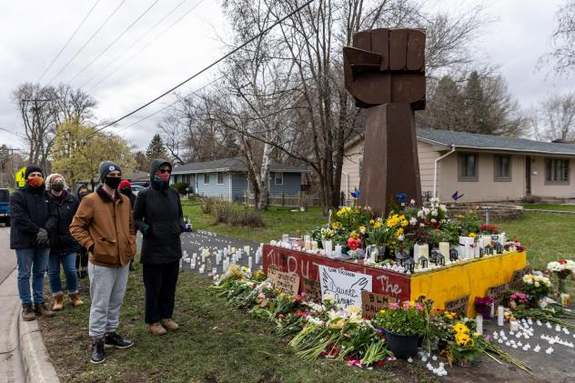 Mourners have built a makeshift memorial for Daunte Wright on the streets of Brooklyn Center, Minn., the quiet inner-ring suburb where police shot and killed Wright on April 11.