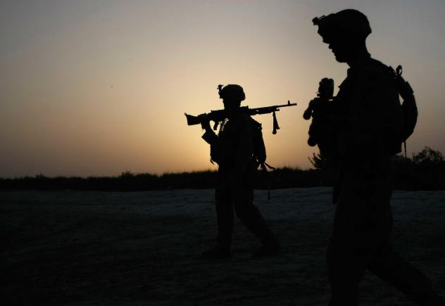 U.S. Marines conduct an operation to clear a village of Taliban fighters on July 5, 2009, in Mian Poshteh, Afghanistan. The U.S. and NATO forces plan to withdraw their remaining troops from Afghanistan by September.