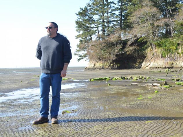 Tony Johnson is chair of the Chinook Indian Nation, a federally unrecognized tribe. He stands on a Willapa Bay, Wash. beach, where he got married and not far from where his ancestors lived.