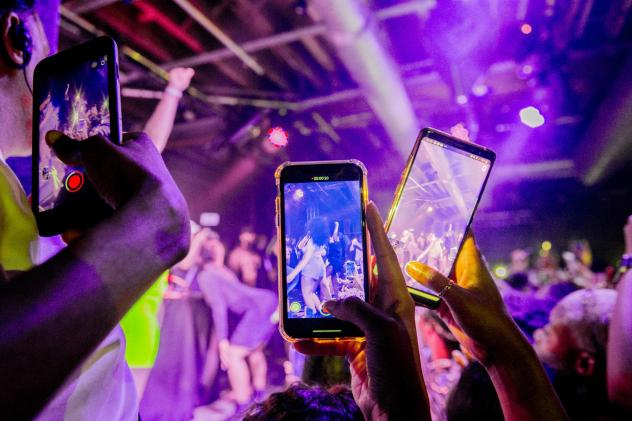You can do a lot of things with minimal risk after being vaccinated. Although our public health expert says that maybe it's not quite time for a rave or other tightly packed events. Above: Fans take photographs of Megan Thee Stallion at a London show in