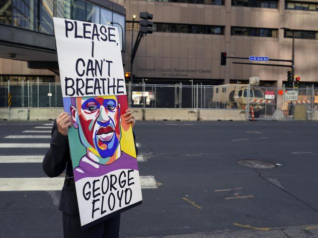 A protester holds a sign across the street from the Hennepin County Government Center in Minneapolis on April 6 during the trial of former police officer Derek Chauvin. The testimony ran for three weeks.