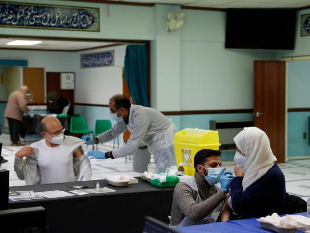 People receive the AstraZeneca COVID-19 vaccine at the Al-Abbas Islamic Center, converted into a vaccination clinic in Birmingham, England, in January. Sheikh Nuru Mohammed, the imam at the mosque, recognized many of his congregants were hesitant to get