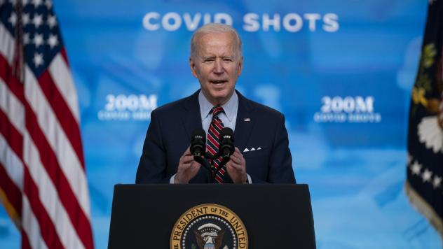 When President Biden arrives to give his speech to a joint session of Congress on Wednesday night, he will be masked as he enters what will be a noticeably less crowded, more socially distanced House chamber. Here, Biden speaks about COVID-19 vaccination