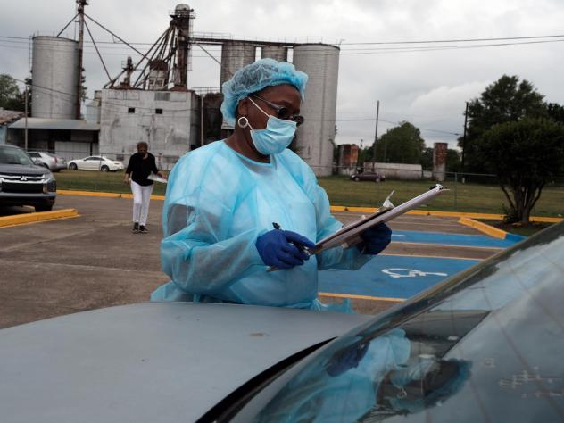 Medical workers with Delta Health Center prepare to vaccinate people in Leland, Miss., last week. In some places, rural hospital workers have been slow to get the vaccine themselves.