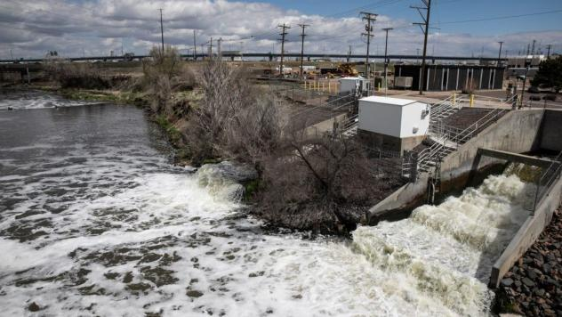 Treated Denver wastewater flows into the South Platte River in April. In what may be the largest U.S. project of its kind, Denver will use excess energy from sewage wastewater to heat and cool a new agriculture, arts and education center.