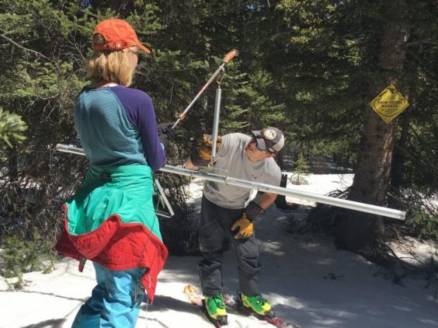 Colorado Snow Survey supervisor Brian Domonkos and civil engineer Madison Gutekunst of the USDA weigh snow to know how much moisture it holds on April 30, 2021.