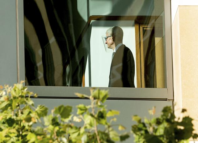 Apple CEO Tim Cook walks through the Ronald V. Dellums building on Friday.