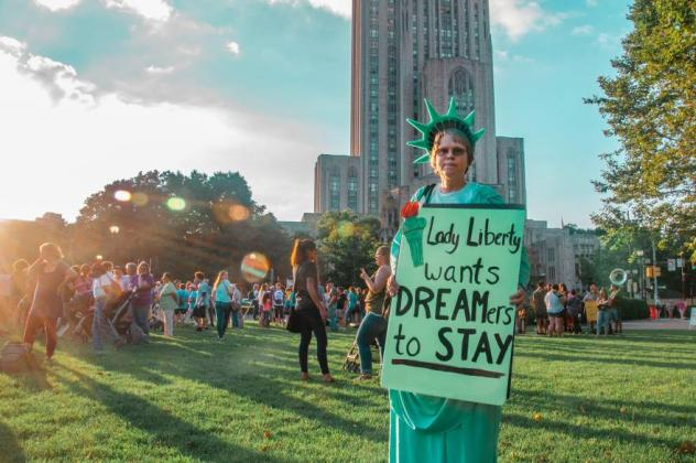 DACA protester Statue of Liberty