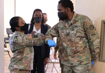 Nearly 130 million U.S. adults have completed their vaccine regimens, the CDC says, with another 70 million vaccine doses currently in the distribution pipeline. Here, Maryland National Guard Brig. Gen. Janeen Birckhead greets soldiers last week at a mob