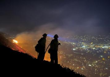 Firefighters battle a brush fire last week in Santa Barbara, Calif. Climate-driven droughts make large, destructive fires more likely around the world. Scientists warn that humans are on track to cause catastrophic global warming this century.
