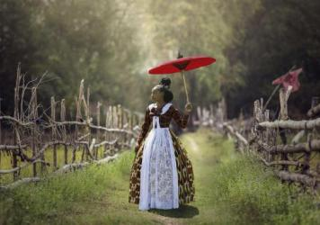 In<em> Voyages of an African Victorian, </em>a woman wears a Victorian-style dress made of African fabrics.