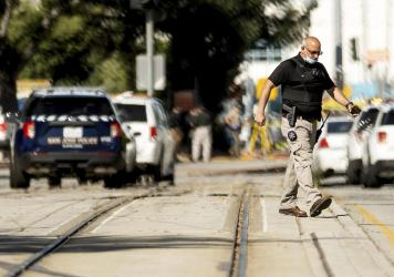 Law enforcement officers respond to a mass shooting at a Santa Clara Valley Transportation Authority facility on Wednesday in San Jose, Calif. A Santa Clara County sheriff's spokesman said the rail yard shooting left multiple people, including the shoote
