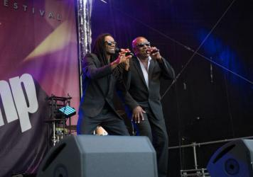 """John Davis (right), on stage with former Milli Vanilli star Fabrice """"Fab"""" Morvan, in Eisenach, Germany in 2018."""