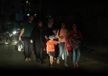 A Palestinian family evacuates their home in the middle of the night during the Israeli bombardment of Gaza.