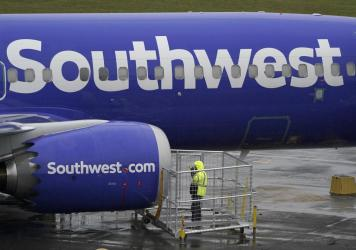 A Southwest Airlines plane in November. A flight attendant for Southwest was allegedly struck by a passenger and lost two teeth in the latest in a rash of violent attacks on planes.