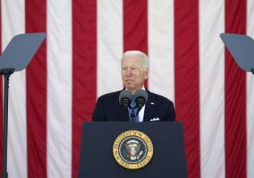 President Joe Biden speaks during the National Memorial Day Observance at Arlington National Cemetery Monday. His budget proposal drops a decades-long ban on public funding for abortion.