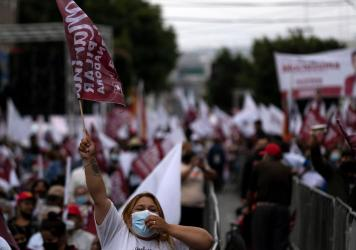 Supporters of the Morena party's candidate for governor of Baja California, Marina del Pilar Ávila, attend the closing campaign rally in Tijuana, Baja California, Mexico, on Wednesday.