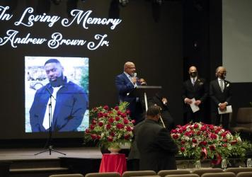 A photo of Andrew Brown Jr. is seen during his funeral, on May 3, in Elizabeth City, N.C. Brown was fatally shot by Pasquotank County Sheriff deputies trying to serve a search warrant.