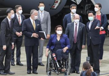 Taiwan's Foreign Minister Joseph Wu (second right) welcomes U.S. senators upon their arrival at the Songshan Airport in Taipei on Sunday. To his right are Democratic Sen. Christopher Coons of Delaware, a member of the Foreign Relations Committee, Democra