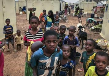Children of about 6,000 ethnic Fulanis who have been displaced by attacks gather in a makeshift camp in Youba, Burkina Faso, in April 2020. The West African nation continues to be racked by violence linked to Islamic extremists and local defense militias