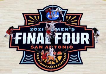 Cameron Brink #22 of the Stanford Cardinal and Cate Reese #25 of the Arizona Wildcats fight for the opening tipoff during the National Championship game of the 2021 NCAA Women's Basketball Tournament at the Alamodome on April 4 in San Antonio, Texas. The