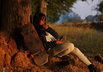 Asha Gond, 21, with her skateboard. She tried the sport when a skatepark was set up in her rural village and is now one of India's top female skateboarders.