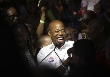 Mayoral candidate Eric Adams mingles with supporters during his election night party, late Tuesday in New York.