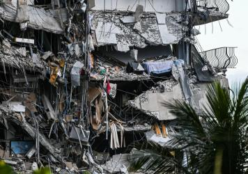 Rubble hangs from a partially collapsed building in Surfside north of Miami Beach on Thursday. The multi-story apartment block in Florida partially collapsed early in the morning, sparking a major emergency response.