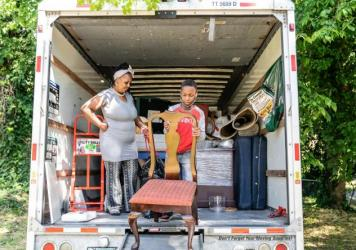 Tasharn Richardson's 11-year-old son, Lionel, helps unload the moving truck at their new home in Washington, D.C. To Tasharn, having a house to call her own always seemed like someone else's dream.