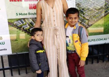 """Poornima Peri, who lives in Melbourne, Australia, with her two sons. Aarit (left), now age 4, is India staying with his grandmother. His mother had planned to pick him up but """"from March [2020] onward it was total lockdown,"""" she says. Because of continui"""
