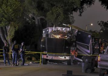 A cache of 5,000 pounds of illegal fireworks seized at a South Los Angeles home exploded and destroyed an armored Los Angeles Police Department tractor-trailer, damaging nearby homes and cars and causing injuries, authorities said.