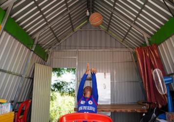 """Sinet An had never touched a basketball before 2013. The key to her success: """"train again and again and practice again and again, to be better and better."""" Because of pandemic lockdowns, she can only practice at home."""