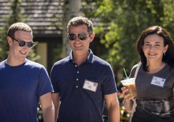 Facebook's CEO Mark Zuckerberg, Vice President of Partnerships Dan Rose and Chief Operating Officer Sheryl Sandberg walk together at the Allen & Company Sun Valley Conference on July 12, 2018 in Sun Valley, Idaho. Top tech and media moguls descend on the