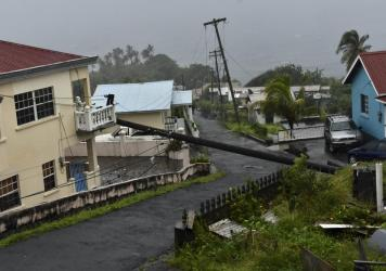 An electrical pole felled by Hurricane Elsa leans on the edge of a residential balcony, in Cedars, St. Vincent. Elsa strengthened into the first hurricane of the Atlantic season on Friday as it blew off roofs and snapped trees in the eastern Caribbean, w
