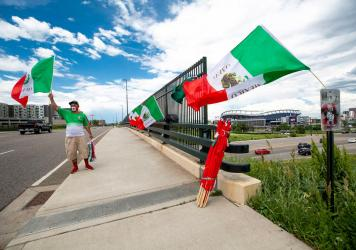 Raul Gomez sells Mexican flags Tuesday before the U.S. and Mexico national teams face off in the CONCACAF Nations League finals at Mile High Stadium.