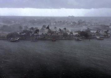 Looking north at the neighborhood of Paradise Island on Treasure Island, Fla., outer bands of Tropical Storm Elsa brings a downpour of rain over the area on Tuesday, July 6, 2021.