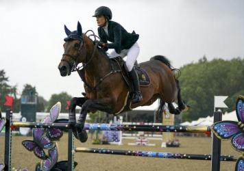 Jessica Springsteen rides Don Juan van de Donkhoeve while competing Sunday in the Rolex Grand Prix at the Royal Windsor Horse Show in England.