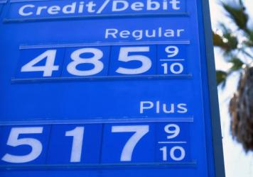 Gas prices are displayed at a Chevron station on June 14 in Los Angeles. A meeting of the oil cartel known as OPEC+ ended in drama, leading to intense volatility in crude prices.