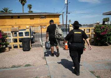 Maricopa County constable Darlene Martinez evicts a tenant on October 7, 2020 in Phoenix, Arizona. Thousands of court-ordered evictions continue nationwide despite a Centers for Disease Control (CDC) moratorium for renters impacted by the coronavirus pan