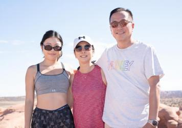 Lindsey Cho (left), with her mother Judy Lee and father Wesley Cho after taking their turn at Delicate Arch.